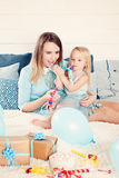 Mother and Daughter Having Fun with Birthday Gift Box Stock Photos