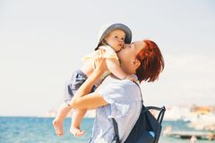 Mother and baby. Family relaxing by the sea. royalty free stock photography