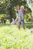 Mother And Daughter Having Fun On Countryside Camping Trip Stock Photos