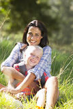 Mother And Daughter Having Fun On Countryside Hike Stock Photo