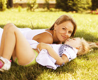 Mother with daughter having fun on grass Stock Photography