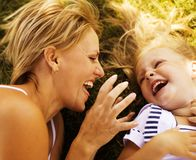 Mother with daughter having fun on grass Royalty Free Stock Image
