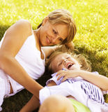 Mother with daughter having fun on grass Royalty Free Stock Photos
