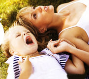 Mother with daughter having fun on grass Royalty Free Stock Photography