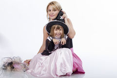 Mother and daughter having fun at Halloween party. Portrait of two, young mother and daughter, having fun at a Halloween party Royalty Free Stock Photo