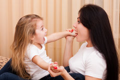 Mother and daughter having fun at home Stock Image