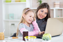 Mother and daughter having fun in the kitchen Stock Photography