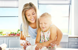 Mother and daughter having fun in the kitchen Stock Image