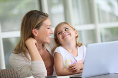 Mother and daughter having fun on a laptop Stock Photography