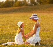 Mother and daughter having fun on the meadow Royalty Free Stock Photography