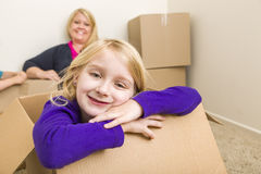 Mother and Daughter Having Fun With Moving Boxes Royalty Free Stock Photos