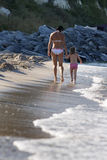 Mother and daughter having fun in the ocean Stock Photo