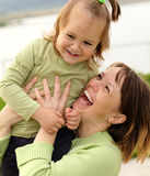 Mother and daughter having fun outdoor Royalty Free Stock Image