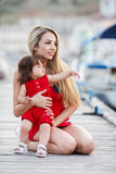 Mother and daughter having fun outside on the dock Royalty Free Stock Images