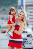 Mother and daughter having fun outside on the dock Royalty Free Stock Image