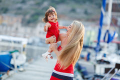 Mother and daughter having fun outside on the dock Royalty Free Stock Photography