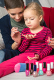 Mother and daughter having fun painting fingernails Royalty Free Stock Photo