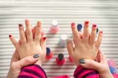 Mother and daughter having fun painting fingernails Royalty Free Stock Images