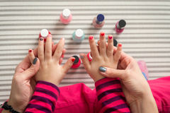 Mother and daughter having fun painting fingernails, view from above Royalty Free Stock Photo