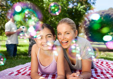 Mother and daughter having fun in the park Royalty Free Stock Image