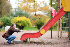 Mother and daughter having fun at playground Royalty Free Stock Photography