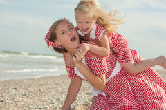 Mother and daughter having fun playing on the beach Royalty Free Stock Photography