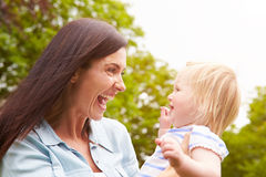 Mother And Daughter Having Fun Playing Game Outdoors Royalty Free Stock Photo