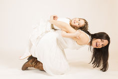 Mother and daughter having fun playing Stock Image