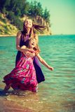 Woman and girl playing in water Royalty Free Stock Photos
