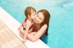 Mother and daughter having fun in the pool. Summer holidays and Stock Image