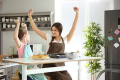 Mother and daughter having fun while preparing dough Royalty Free Stock Photography