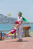 Mother and daughter having fun on promenade Stock Image