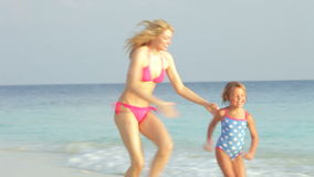 Mother And Daughter Having Fun In Sea On Beach Holiday stock footage