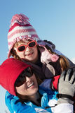 Mother And Daughter Having Fun On Ski Holiday Royalty Free Stock Image