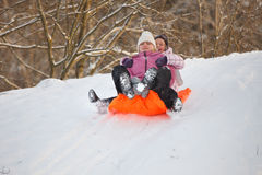 Mother and daughter having fun in snow Royalty Free Stock Images
