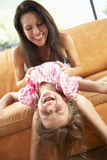 Mother And Daughter Having Fun On Sofa Stock Photos