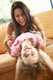 Mother And Daughter Having Fun On Sofa Stock Photography