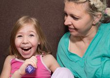 Mother And Daughter Having Fun On Sofa Royalty Free Stock Images