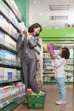 Mother and Daughter Having Fun in Supermarket Stock Photography