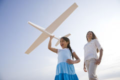 Mother and daughter having fun with toy plane Royalty Free Stock Photos