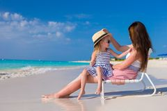 Mother and daughter having fun at tropical beach Royalty Free Stock Image