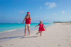 Mother and daughter having fun at tropical beach Stock Photography