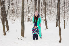 Mother and daughter having fun in the winter park Stock Image