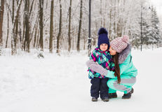 Mother and daughter having fun in the winter park Stock Images