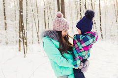Mother and daughter having fun in the winter park Royalty Free Stock Image
