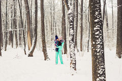 Mother and daughter having fun in the winter park Stock Photography