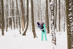 Mother and daughter having fun in the winter park Royalty Free Stock Images