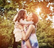 Mother and daughter having a great fun in the park royalty free stock photo