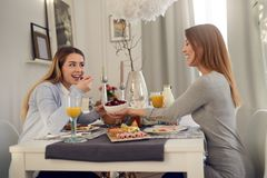 Mother and daughter having an intimate conversation. Over lunch offering family support and understanding conceptual of parenting Royalty Free Stock Image