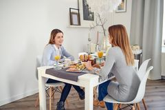 Mother and daughter having an intimate conversation. Over lunch offering family support and understanding conceptual of parenting Stock Photography